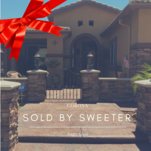 "Front view of home with red bow and caption ""Sold by Sweeter"""